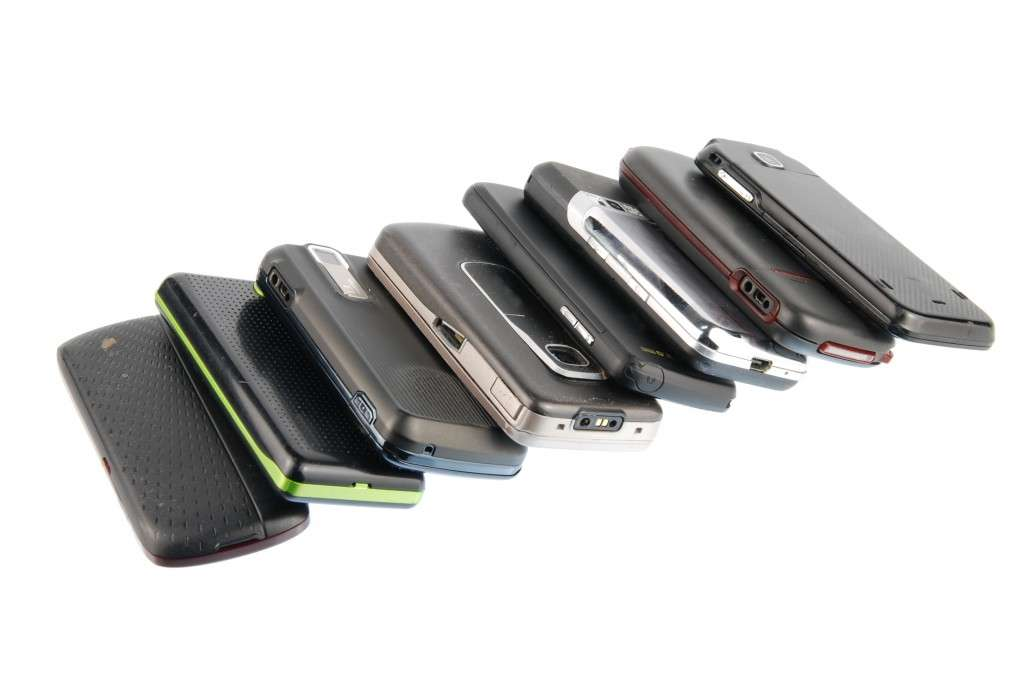 Row of modern mobile phones on white (photo: graphicstock.com)