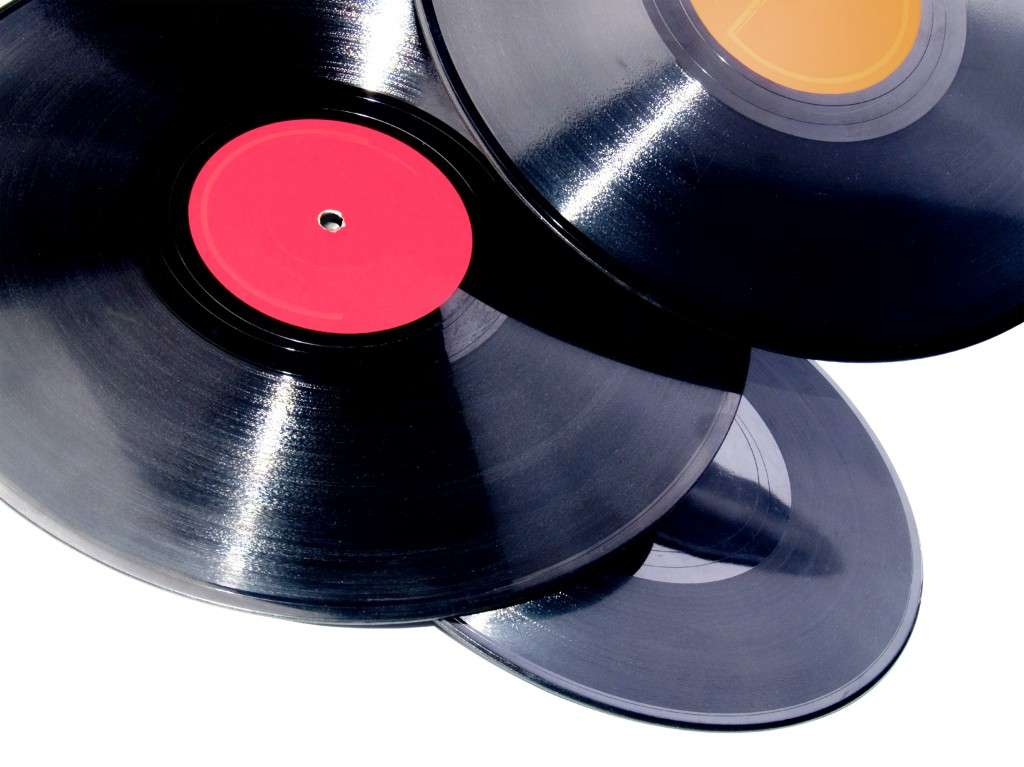 Vinyl records isolated in white (photo credit: graphicstock.com)